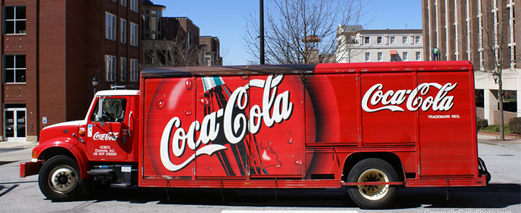 Coca Cola wrapped bottle truck