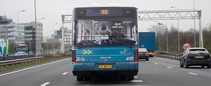 Centraal Beheer Man Driving Backwards Bus Wrap